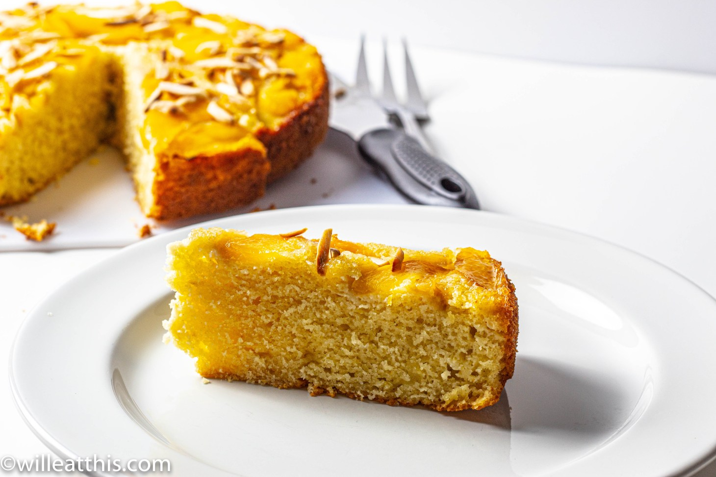 Slice of Upside Down Peach Olive Oil cake