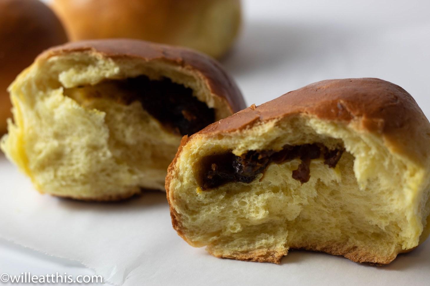 A split tumeric bun stuffed with raisin