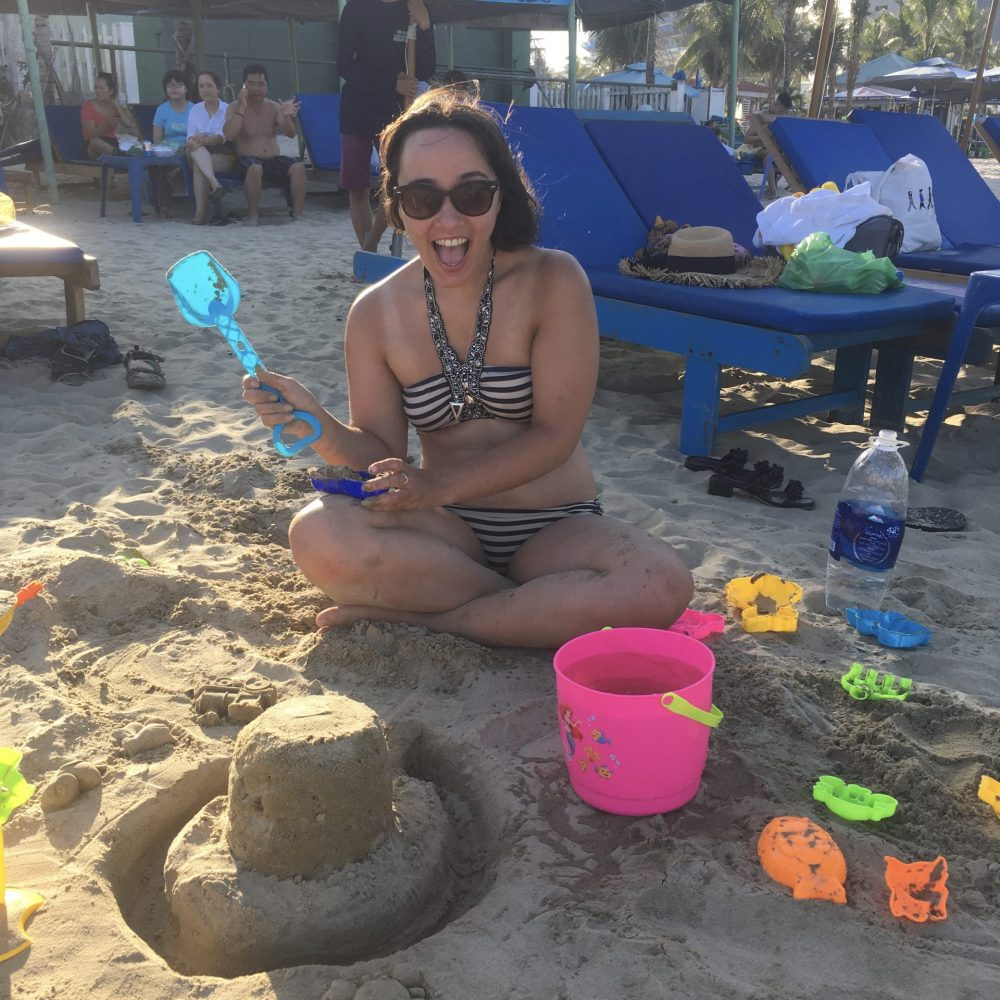 Eleanor making a sandcastle