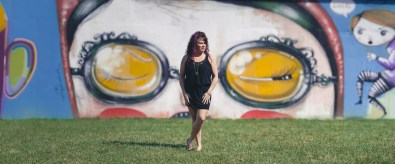 panorama of woman in front of mural in annapolis