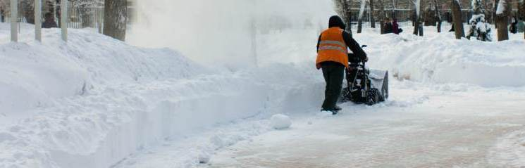 man doing snow removal