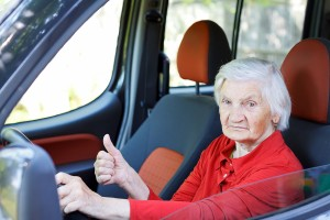 Picture of a confident senior woman driving a car