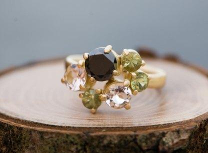 Black diamond cluster ring in gold