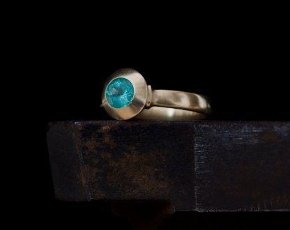 Blue green Columbian emerald set in 18k gold ring