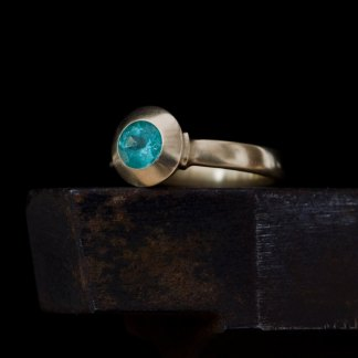 Blue green Columbian emerald set in 18k gold ring