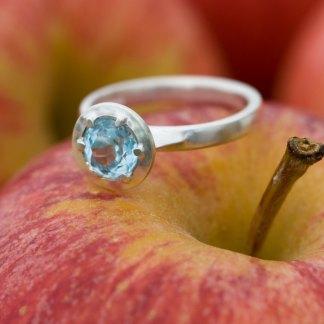 Swiss blue topaz alternative engagement ring in silver