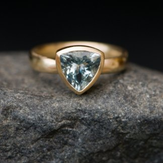 aquamarine gold ring with trillion cut stone