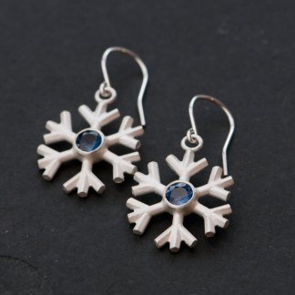 Charming Blue sapphire snowflake earrings, set in sterling silver. These delicate snowflakes are designed and handmade by William White in Cornwall, UK