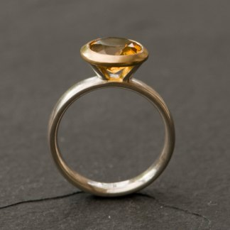 Strong yellow citrine in gold and silver ring. By William White