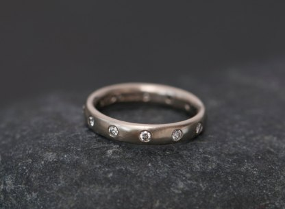 Diamond eternity ring in 18k gold. By William White