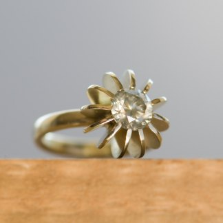 Diamond set into sea urchin design ring in gold
