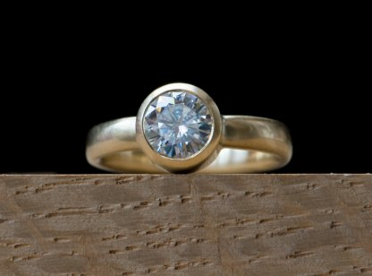 contemporary ring with moissanite solitaire set in 18k yellow gold