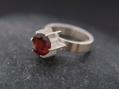 Deep red garnet fin ring in satin finished sterling silver. By William White