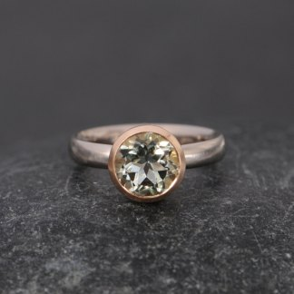 pale green amethyst set in yellow gold bezel on white gold ring