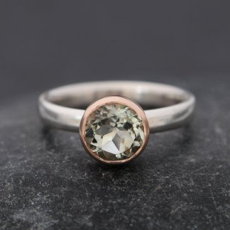pale green amethyst set in gold bezel on sterling silver ring