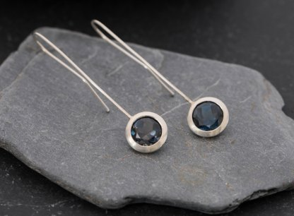 Deep blue, clean and simple London blue topaz 'lollipop' earrings, set in sterling silver. Adjustable length earrings designed and handmade by William White