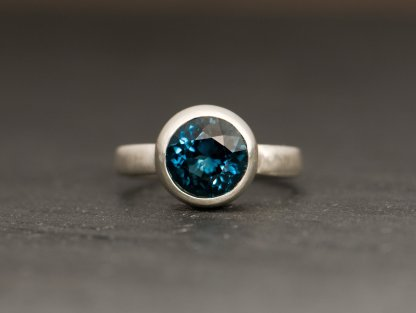 large Blue topaz solitaire set in silver ring. By William White