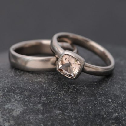 cushion cut morganite set in 18k gold ring, with matching wedding band. By William White