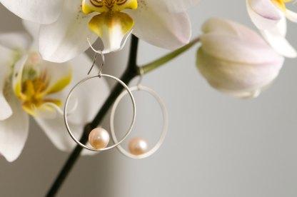 Peach pearl hoop earrings in silver. By William White
