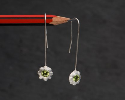 Green peridot flower earrings in silver. By William White