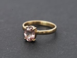 pink zircon solitaire claw set in 18k gold ring