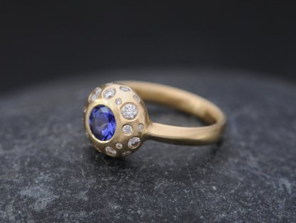 tanzanite and diamond cluster ring set in gold