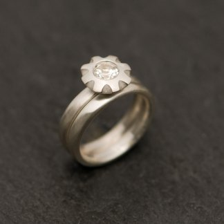 White topaz wedding set featuring topaz flower ring and wedding band in sterling silver