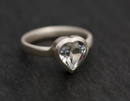 Heart shaped white topaz, set in satin finished sterling silver. This is a really pretty topaz ring.