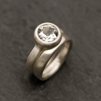 white topaz wedding set, engagement ring and wedding band in silver