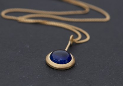 Brigh blue sapphire lollipop pendant on 18k yellow gold chain by William White