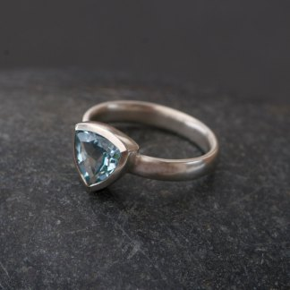 Trillion cut sky blue topaz set in sterling silver ring