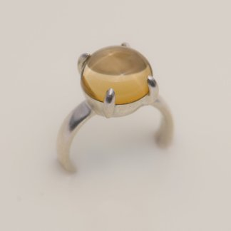 large citrine cabochon claw set in silver
