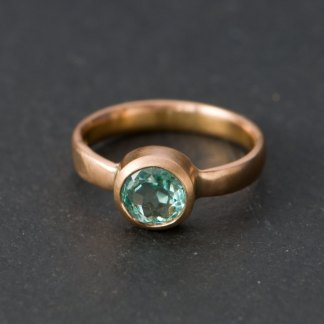 Pale green Columbian emerald set in rose gold ring