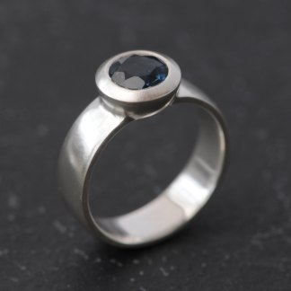 London blue topaz stone set in satin finished sterling silver ring
