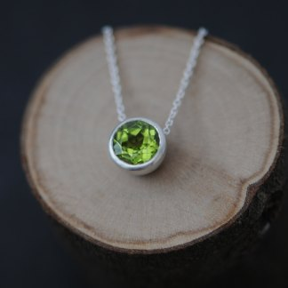 Apple green Peridot necklace in satin finished sterling silver on silver chain. By William White.