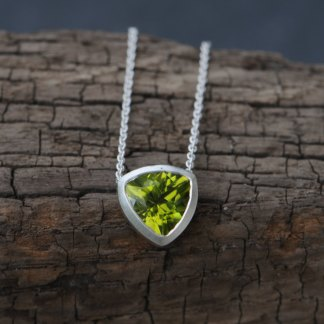 Beautiful bright green peridot necklace, set in a satin finished sterling silver pendant on a silver chain by William White
