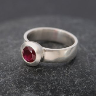 Ruby solitaire set in silver ring