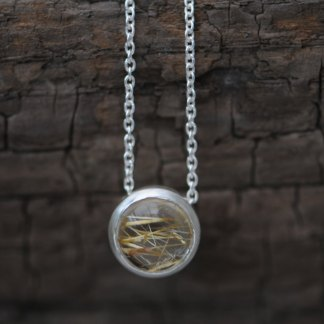 Simple Rutilated Quartz pendant necklace, in sterling silver on a silver chain. Choice of chain lengths. Designed & handmade by William White in Cornwall.