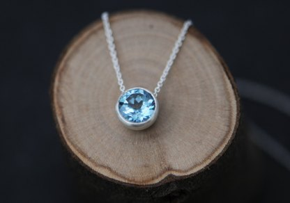 Lovely sky blue topaz, set in satin finished sterling silver pendant on a silver chain. Designed and handmade in Cornwall, UK by William White