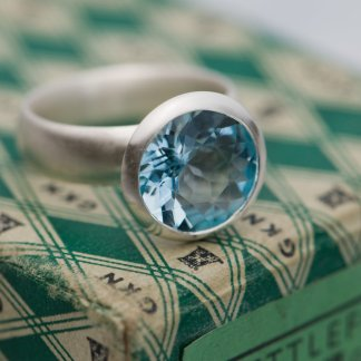 Large sky blue topaz stone set in silver ring