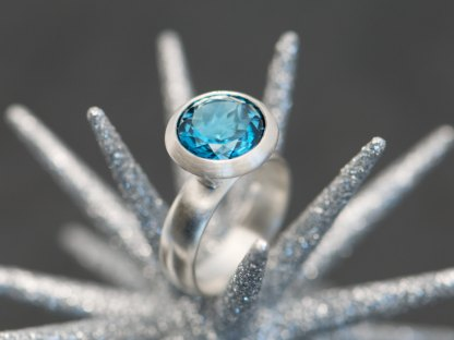 Bright Swiss blue topaz solitaire ring in sterling silver