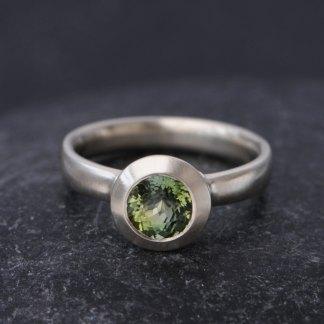 green tourmaline stone set in white gold ring