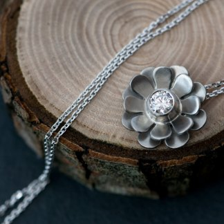 Beautiful White Diamond flower pendant, set in 18k white gold on a white gold chain. Choice of chain lengths. Designed & handmade by William White