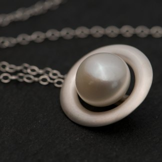 White pearl halo necklace in satin finished sterling silver. Made by William White