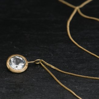Clean and simple white topaz 'lollipop' necklace, set in 18k yellow gold - on an 18k yellow gold chain by William White