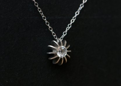 Stunning simple White Topaz sea urchin necklace, set in sterling silver. Designed and handmade in Cornwall, UK by William White.