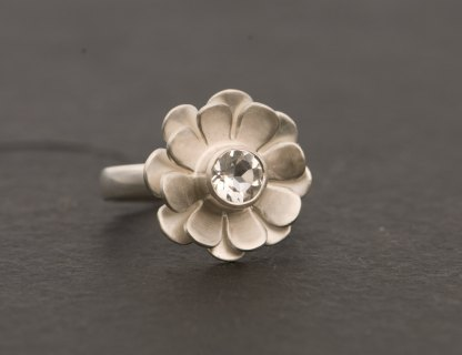 White topaz solitaire set in silver daisy ring