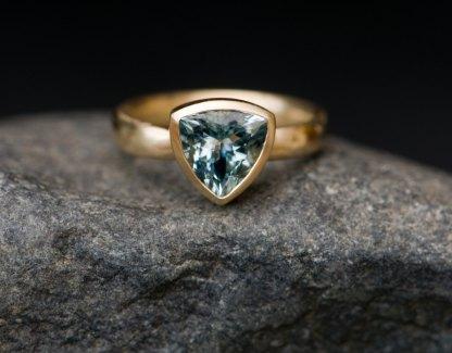 Aquamarine trillion ring in yellow gold