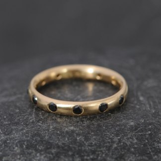 Black diamond eternity ring in gold