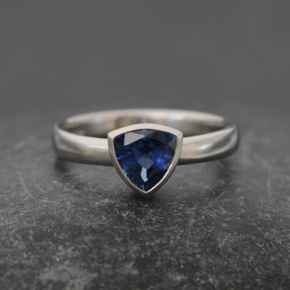 Blue Sapphire trillion stone in a platinum band